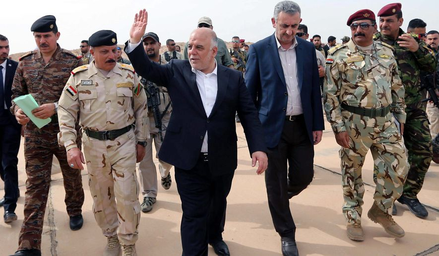 Iraqi Prime Minister Haider al-Abadi arrived last week to distribute weapons and support security forces and Sunni volunteers at a camp in Habaniyah, west of Baghdad. After victory against Islamic State militants in the city of Tikrit, Iraq set sights on western Anbar province for its second major counteroffensive against the Islamic State. (Associated Press)