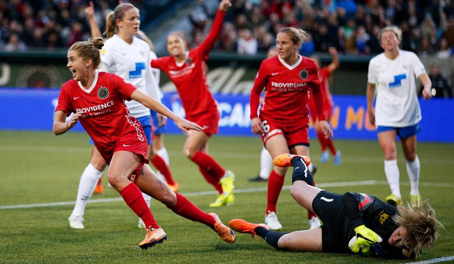 Portland Thorns Sinead Farrelly celebrates her first-half goal against the Boston Breakers in the Thorns' season-opening NWSL match at Providence Park in Portland on Saturday April 11, 2015. (AP Photo/The Oregonian, Randy L. Rasmussen)