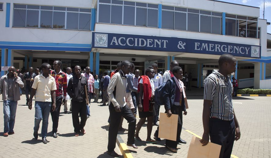 University students leave after treatment at Kenyatta National Hospital, Sunday, April 12, 2015, in Nairobi, Kenya. One Kenyan student was killed and 141 injured in a stampede Sunday on the campus of the University of Nairobi when students mistook several accidental explosions for another extremist attack, according to an official. (AP Photo/Sayyid Azim)