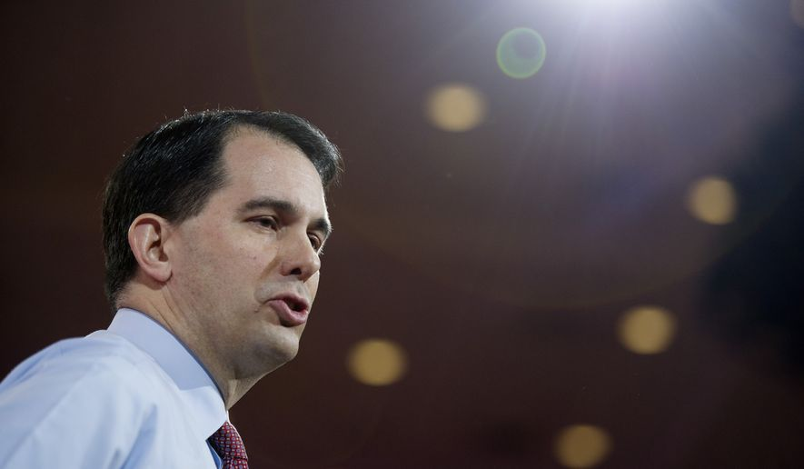 Wisconsin Gov. Scott walker was among the 2016 Republican hopefuls to decry Mr. Obama's performance, both domestically and in managing overseas conflicts, at the NRA's annual convention in Nashville. (Associated Press)