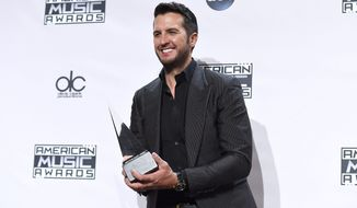 Luke Bryan, winner of the award for favorite country male artist, poses in the press room at the 42nd annual American Music Awards at Nokia Theatre L.A. Live on Sunday, Nov. 23, 2014, in Los Angeles. (AP)