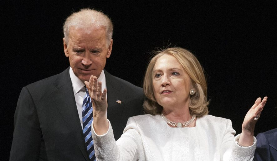 In this April 2, 2013, file photo Vice President Joe Biden and former Secretary of State Hillary Rodham Clinton are seen in Washington. (AP Photo/Cliff Owen, File)