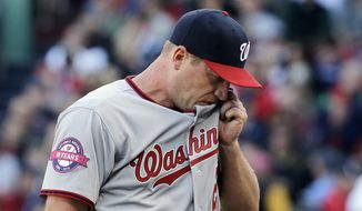 Washington Nationals starting pitcher Jordan Zimmermann walks to the dugout after being pulled in the third inning of the home opener baseball game against the Boston Red Sox at Fenway Park in Boston, Monday, April 13, 2015. (AP Photo/Elise Amendola)