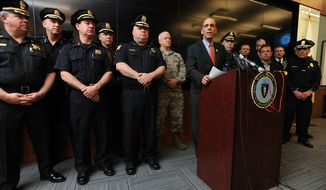At Massachusetts Emergency Management Agency (MEMA) headquarters in Framingham, Mass., director Kurt Scwartz, at podium, talks with media about public safety planning for the 2015 Boston Marathon, Monday, April 13, 2015. Enhanced security measures will remain in place for next Monday's Boston Marathon, the second since the deadly 2013 bombing at the finish line of the iconic race, authorities said. (Allan Jung/The Metro West Daily News via AP)
