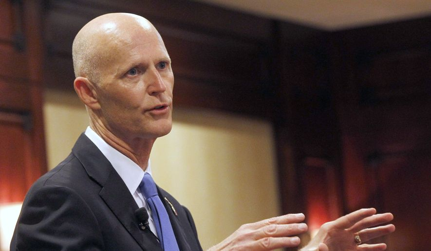 Republican Florida Gov. Rick Scott speaks during during the Valley Industry and Commerce Association (VICA) Leaders Forum in the Woodland Hills area of Los Angeles on April 13, 2015. (Associated Press) **FILE**