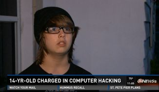 Domanik Green, an eighth-grader at at Paul R. Smith Middle School, was arrested in Pasco County on cybercrime charges last week after he gained unauthorized access to his teacher's computer and changed the desktop image to a photo of two men kissing. (WTSP-TV)