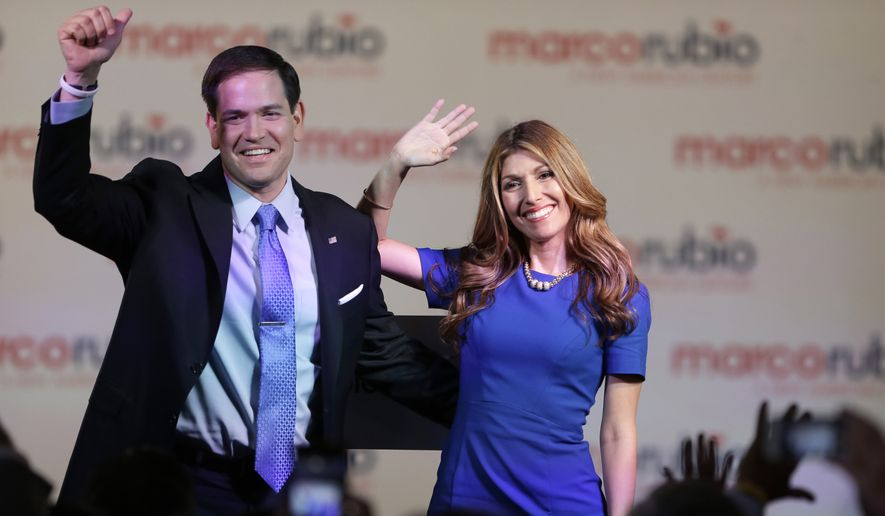 Florida Sen. Marco Rubio waves to supporters with his wife Jeanette, after he announced that he will be running for the Republican presidential nomination, during a rally at the Freedom Tower, Monday, April 13, 2015, in Miami. (AP Photo/Wilfredo Lee)