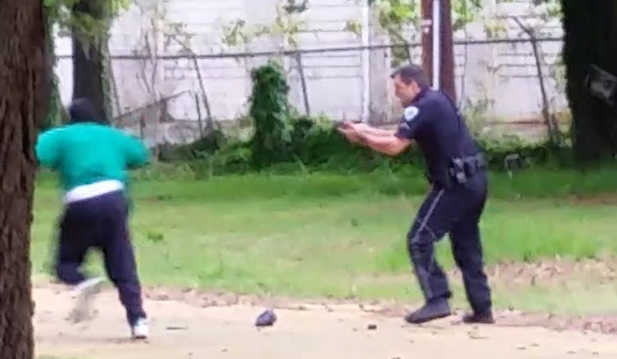 FILE - In this April 4, 2015, file photo, from video provided by Attorney L. Chris Stewart representing the family of Walter Lamer Scott, Scott appears to be running away from City Patrolman Michael Thomas Slager, right, in North Charleston, S.C. Slager was charged with murder on Tuesday, April 7, hours after law enforcement officials viewed the dramatic video that appears to show him shooting a fleeing Scott several times in the back. (AP Photo/Courtesy of L. Chris Stewart, File)