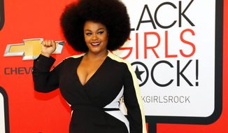 In this March 28, 2015 file photo, Jill Scott wears a black and white jumpsuit at the Black Girls Rock award ceremony at the New Jersey Performing Arts Center in Newark, N.J. (AP Photo/Julio Cortez, File)