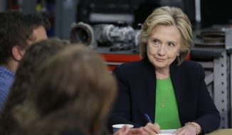 Democratic presidential candidate Hillary Rodham Clinton takes notes during a roundtable with educators and students at the Kirkwood Community College's Jones County Regional Center, Tuesday, April 14, 2015, in Monticello, Iowa. (AP Photo/Charlie Neibergall)