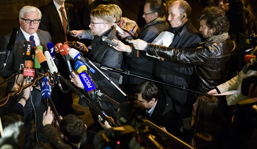 German Foreign Minister Frank-Walter Steinmeier speaks to journalists after a meeting of foreign ministers of Germany, France, Russia and Ukraine at Villa Borsig, the official guest house of the foreign ministry, in Berlin in the early hours of Tuesday, April 14, 2015. Russia and Ukraine agreed Monday to call for the pullback of smaller caliber weapons from the front lines in eastern Ukraine as part of a fresh push to end the region's yearlong conflict. Foreign ministers from the two countries — meeting with their French and German counterparts in Berlin — also agreed to support international monitors and establish four working groups to address the most pressing issues faced by people in the embattled region, where Russian-backed separatists are fighting Ukrainian government forces. (Clemens Bilan/Pool Photo via AP)