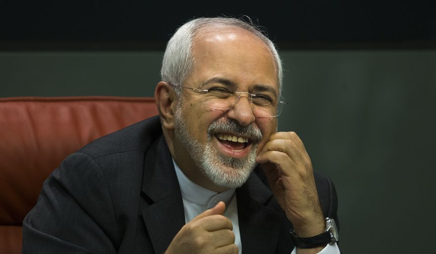 Iranian Foreign Minister Mohammad Javad Zarif laughs during a press conference with his Spanish counterpart Manuel Garcia Margallo in Madrid, Spain, Tuesday, April 14, 2015. (AP Photo/Andres Kudacki) ** FILE **