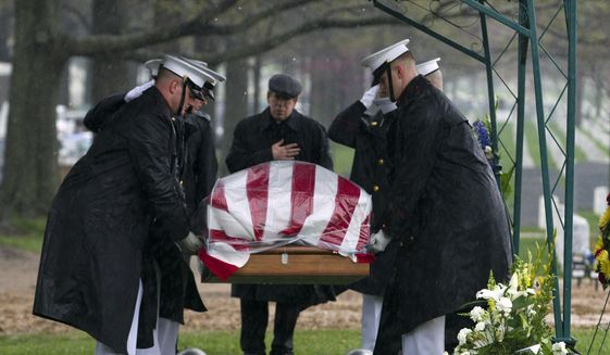 A Marine honor guard at a funeral at Arlington National Cemetery is shown in this file photo from April 2015. (AP Photo/Jose Luis Magana) **FILE**