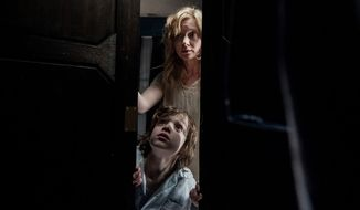 Amelia and Samuel Vannick look for a monster in the movie The Babadook: Special Edition, now available in the Blu-ray format.