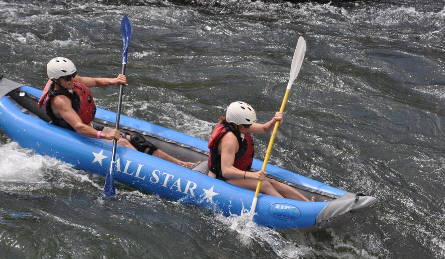 In this July 11, 2014, photo, people paddle through Oak Springs Rapids on the Deschutes River, one of the biggest rapids on the most-used segment of the river in Maupin, Ore. (Terry Richard/The Oregonian via AP) MAGS OUT; TV OUT; NO LOCAL INTERNET; THE MERCURY OUT; WILLAMETTE WEEK OUT; PAMPLIN MEDIA GROUP OUT