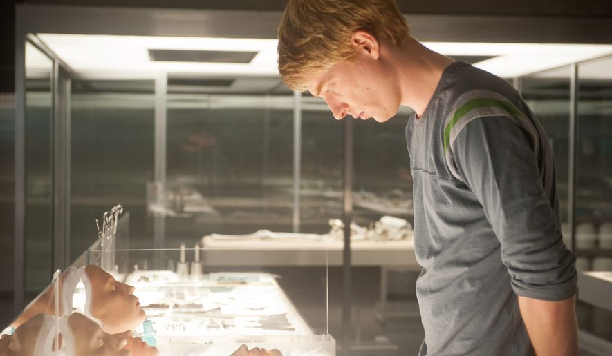 """Domhnall Gleeson appears in a scene from """"Ex Machina,"""" an intelligent sci-fi mystery that explores the notions of consciousness, sentience and whether """"artificial"""" intelligence is, in fact, real. Mr. Gleeson plays Caleb, a computer coder assigned to interact with his company's latest artificial intelligence model, Ava. (Associated Press photographs)"""