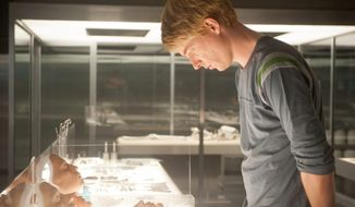 "Domhnall Gleeson appears in a scene from ""Ex Machina,"" an intelligent sci-fi mystery that explores the notions of consciousness, sentience and whether ""artificial"" intelligence is, in fact, real. Mr. Gleeson plays Caleb, a computer coder assigned to interact with his company's latest artificial intelligence model, Ava. (Associated Press photographs)"