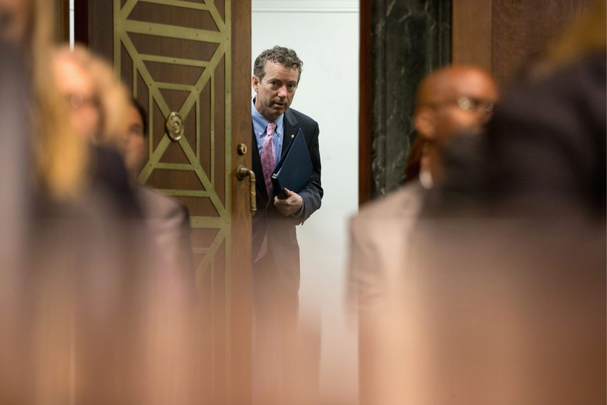 In a crowded GOP field, presidential candidate Sen. Rand Paul, Kentucky Republican, stands out for his views on foreign policy and immigration, analysts say. (Associated Press)