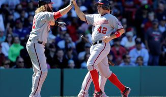 The Nationals' Ryan Zimmerman (right) is congratulated by Jayson Werth after scoring on a three-run double by Wilson Ramos in a 10-5 win over the Red Sox on Wednesday. (Associated Press)