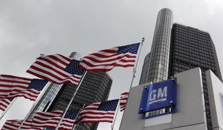 FILE - This April 21, 2009, file photo shows General Motors world headquarters in Detroit. A federal bankruptcy judge ruled Wednesday, April 15, 2015, that General Motors is shielded from death and injury claims potentially totaling billions of dollars tied to defective ignition switches in certain GM small cars. (AP Photo/Paul Sancya, File)