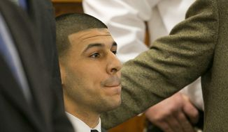 Former New England Patriots football player Aaron Hernandez listens as the guilty verdict is read during his murder trial, Wednesday, April 15, 2015. at Bristol County Superior Court in Fall River, Mass. Hernandez was found guilty of first-degree murder in the shooting death of Odin Lloyd in June 2013.  He faces a mandatory sentence of life in prison without parole.  (Dominick Reuter/Pool Photo via AP)