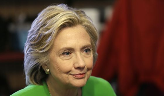 Hillary Rodham Clinton, who resigned from the Clinton Foundation's board, has faced mounting criticism over the charity's ties to foreign governments. (Associated Press) ** FILE **