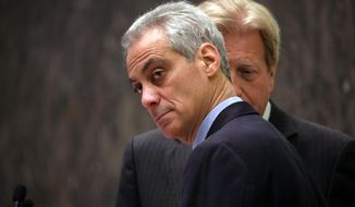 Chicago Mayor Rahm Emanuel, left, with corporation counsel Steve Patton by his side, presides over the Chicago City Council for the first time after being re-elected mayor, Wednesday, April 15, 2015, in Chicago. (Nancy Stone/Chicago Tribune via AP)