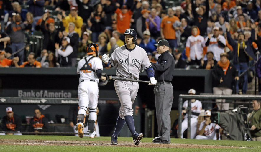 New York Yankees designated hitter Alex Rodriguez walks off the field after striking out looking to end the top of the eighth inning of a baseball game against the Baltimore Orioles, Wednesday, April 15, 2015, in Baltimore. Baltimore won 7-5. (AP Photo/Patrick Semansky)