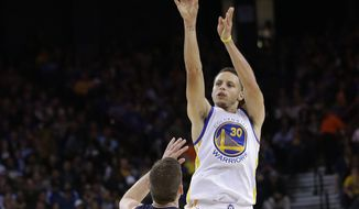 Golden State Warriors' Stephen Curry (30) shoots over Memphis Grizzlies' Beno Udrih during the second half of an NBA basketball game Monday, April 13, 2015, in Oakland, Calif. (AP Photo/Marcio Jose Sanchez)