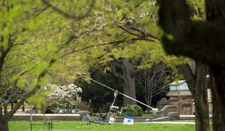 A small helicopter sits on the West Lawn of the Capitol in Washington, Wednesday, April 15, 2015. ?The U.S. Capitol Police is investigating a gyro copter with a single occupant that has landed on the grassy area of the West Lawn of t?he U.S. Capitol. The U.S. Capitol Police continues to investigate with one person detained and temporary street closures in the immediate area.  (AP Photo/Andrew Harnik)