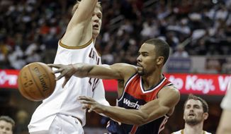 Washington Wizards' Ramon Sessions fires a pass past Cleveland Cavaliers' Timofey Mozgov, from Russia, in the second quarter of an NBA basketball game Wednesday, April 15, 2015, in Cleveland. (AP Photo/Mark Duncan) **FILE**