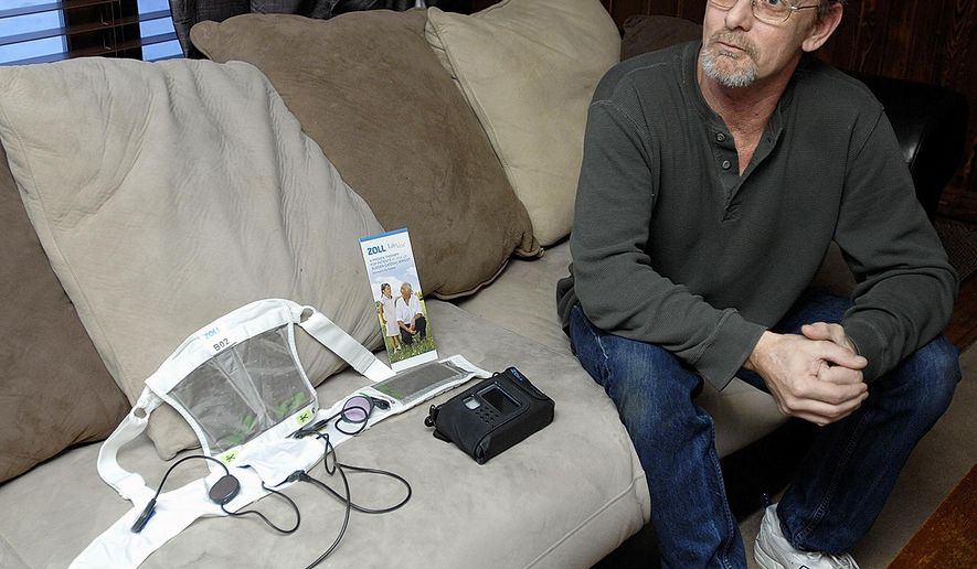 ADVANCE FOR USE SATURDAY, APRIL 18 AND THEREAFTER - In this March 1, 2015, 2015 photo, Mark Humble talks at his house in Normal, Ill., about the life-saving wearable defibrillator vest which saved his life after he suffered a heart attack on Christmas Day. (Lori Ann Cook-Neisler/The Pantagraph via AP)