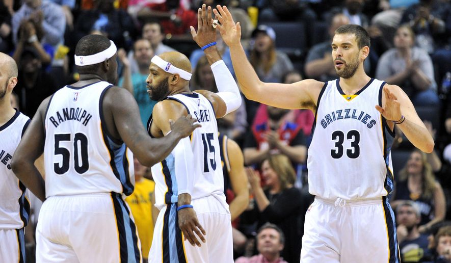 Memphis Grizzlies center Marc Gasol (33) high-fives teammates Zach Randolph (50) and Vince Carter (15) after scoring in the second half of an NBA basketball game against the Indiana Pacers on Wednesday, April 15, 2015, in Memphis, Tenn. (AP Photo/Brandon Dill)