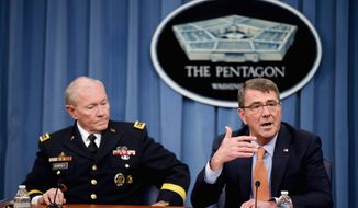 Joint Chiefs Chairman Gen. Martin Dempsey (left) briefing reporters alongside new Defense Secretary Ashton Carter, said the U.S. military is focusing its assistance more heavily on protecting the strategic city of Baiji than on Ramadi, the capital of Al Anbar province. (Associated Press)