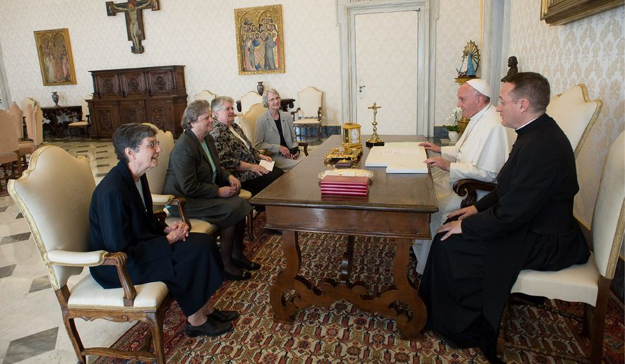 Face to Face: Pope Francis met Thursday with a delegation of the Leadership Conference of Women Religious, and the Vatican announced an end to a conflict with the umbrella group of U.S. nuns in a major shift in tone. (Associated Press)