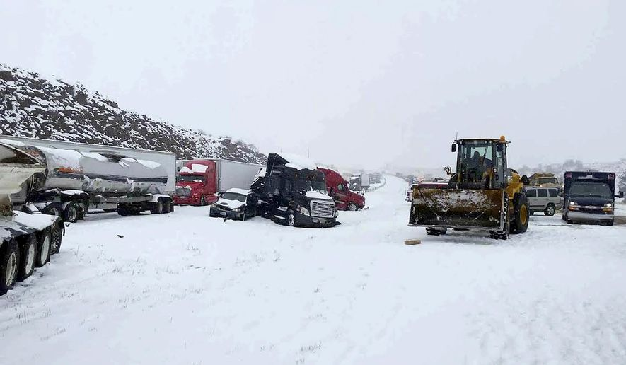 This Thursday, April 16, 2015 photo released by the Wyoming Highway Patrol shows a vehicle pileup west of Cheyenne, Wyo. The Wyoming Highway Patrol reports some 40 to 60 vehicles involved in crashes west of Cheyenne on both sides of the highway. No fatalities have been reported but there are some injuries. (Duane Ellis/Wyoming Highway Patrol via AP)