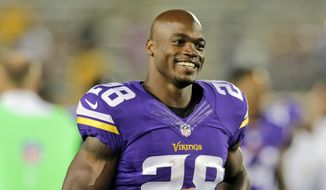 FILE - In this Aug. 8, 2014, file photo, Minnesota Vikings running back Adrian Peterson leaves the field after an NFL preseason football game against the Oakland Raiders in Minneapolis. The NFL has reinstated Minnesota Vikings running back Adrian Peterson, clearing the way for him to return after missing most of last season while facing child abuse charges in Texas. The league announced its decision on Thursday, April 16, 2015. (AP Photo/Jim Mone, File)