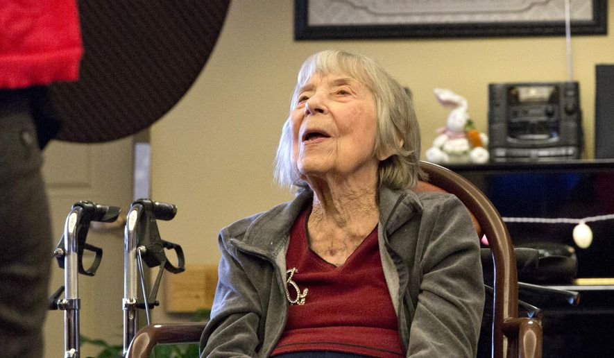 In this photo taken on Monday, April 6, 2015, resident Ruth Smith sings along during music therapy at Amber Way of the Heritage Community in Kalamazoo, Mich. The goal of the music therapy program at Amber Way is to work on memory recall through hearing songs the residents know, peer to peer interaction by trading instruments and fine and gross motor skills by playing percussion instruments and doing stretches. (AP Photo/Kalamazoo Gazette-MLive Media Group, Crystal Vander Weit ) ALL LOCAL TELEVISION OUT; LOCAL TELEVISION INTERNET OUT