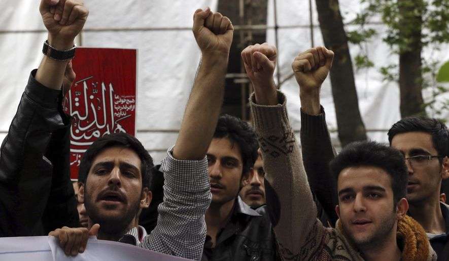 Iranian university students chant slogans in an anti-Saudi protest in front of the U.N. office in Tehran. (AP Photo/File)