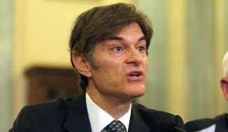 Dr. Mehmet Oz, vice chairman and professor of surgery, Columbia University College of Physicians and Surgeons, testifies on Capitol Hill in Washington in this June 17, 2015, file photo. Ten top physicians want Columbia University to remove the celebrity doctor from his medical faculty position. (AP Photo/Lauren Victoria Burke, File)