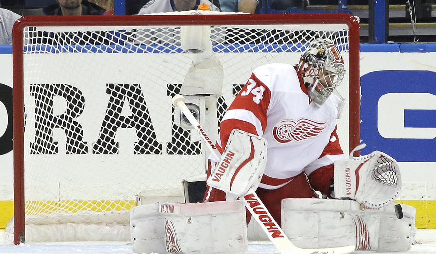 Detroit Red Wings goalie Petr Mrazek, of the Czech Republic, makes a save on a shot by the Tampa Bay Lightning during the first period of Game 1 of an NHL hockey first-round playoff series Thursday, April 16, 2015, in Tampa, Fla. (AP Photo/Chris O'Meara)