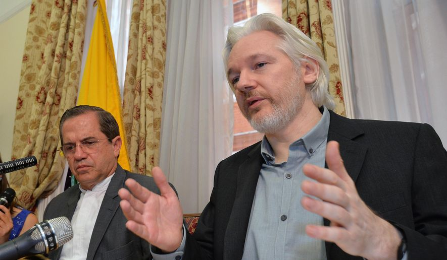 Ecuador's Foreign Minister Ricardo Patino, left, and WikiLeaks founder Julian Assange speak during a news conference inside the Ecuadorian Embassy in London in this Aug. 18, 2014, file photo. (John Stillwell/Pool Photo via AP, File)