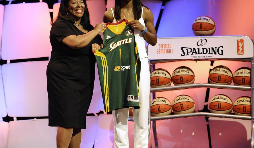 Notre Dame's Jewell Loyd, right, holds up a Seattle Storm jersey with WNBA president Laurel J. Richie after the Storm selected Loyd as the No. 1 pick in the WNBA basketball draft, Thursday, April 16, 2015, in Uncasville, Conn. (AP Photo/Jessica Hill)
