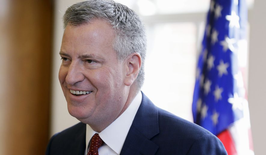 """The average New Yorker throws out nearly 15 pounds of waste a week, adding up to millions upon millions of tons a year,"" New York City Mayor Bill de Blasio said. ""To be a truly sustainable city, we need to tackle this challenge head on."" (Associated Press)"