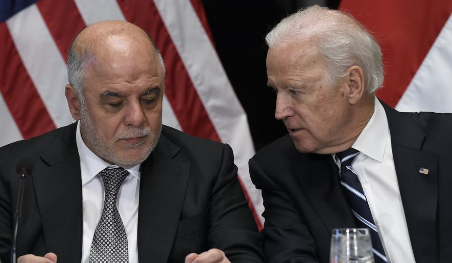 Vice President Joe Biden talks with Iraq's Prime Minister Haider Al-Abadi during a session of the U.S.-Iraq Higher Coordinating Committee, Thursday, April 16, 2015, in the Indian Treaty Room of the Eisenhower Executive Office Building on the White House complex in Washington. (AP Photo/Susan Walsh) ** FILE **