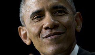 President Obama pauses as he speaks in the South Court Auditorium of the Eisenhower Executive Office Building on the White House complex in Washington, Thursday, April 16, 2015, during a Champions of Change event highlighting issues important to working families. (AP Photo/Carolyn Kaster) ** FILE **