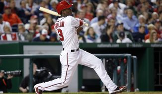 Washington Nationals' Michael Taylor watches his solo home run during the fifth inning of a baseball game against the Philadelphia Phillies at Nationals Park, Thursday, April 16, 2015, in Washington. (AP Photo/Alex Brandon)