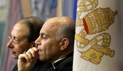 In this Nov. 12, 2012 file photo, Archbishop Salvatore Cordileone, of San Francisco, center, and Archbishop William Lori, of Baltimore, listen to a speaker during the United States Conference of Catholic Bishops' annual fall meeting in Baltimore. Local Catholics have gone public with their complaints about the San Francisco archbishop. On Thursday, April 16, 2015, an advertisement in the San Francisco Chronicle shows more than 100 Catholics have signed a full-page newspaper advertisement asking Pope Francis to remove Cordileone. (AP Photo/Patrick Semansky/File)