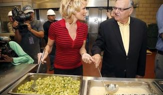 Animal rights activist and PETA spokeswoman Pamela Anderson joined Arizona Sheriff Joe Arpaio on Wednesday to feed inmates a meat-free lunch. (Maricopa County Sheriff's Office)