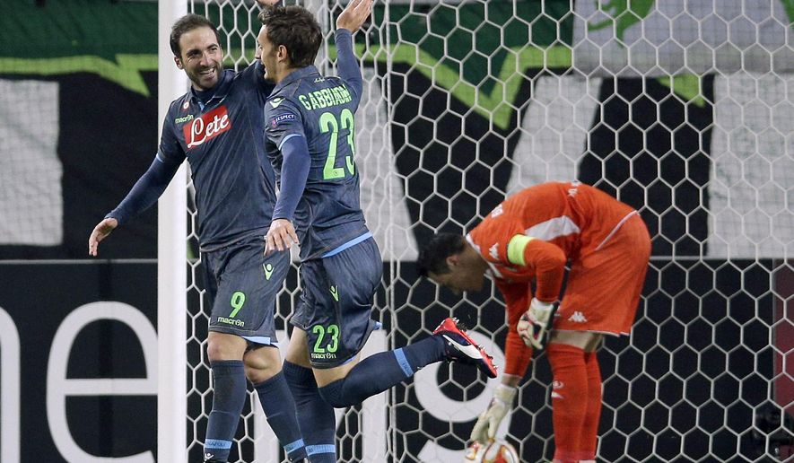 Napoli's scorer Manolo Gabbiadini, front, and his teammate Gonzalo Higuain, left, celebrate their side's 4th goal during the Europa League quarterfinal first leg soccer match between VfL Wolfsburg and SSC Napoli in Wolfsburg, Germany, Thursday, April 16, 2015. (AP Photo/Michael Sohn)